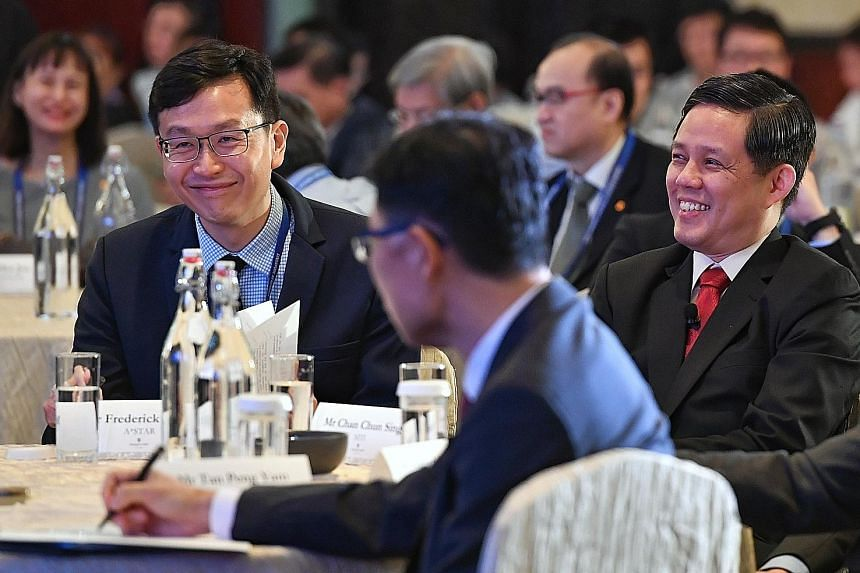 Trade and Industry Minister Chan Chun Sing (right) with Agency for Science, Technology and Research CEO Frederick Chew at the Singapore Aerospace Technology Leadership Forum yesterday.