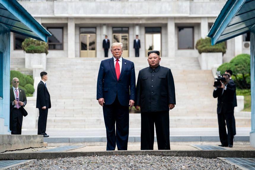 US President Donald Trump and North Korean leader Kim Jong Un at the Demilitarised Zone separating the two Koreas in Panmunjom on June 30, 2019.
