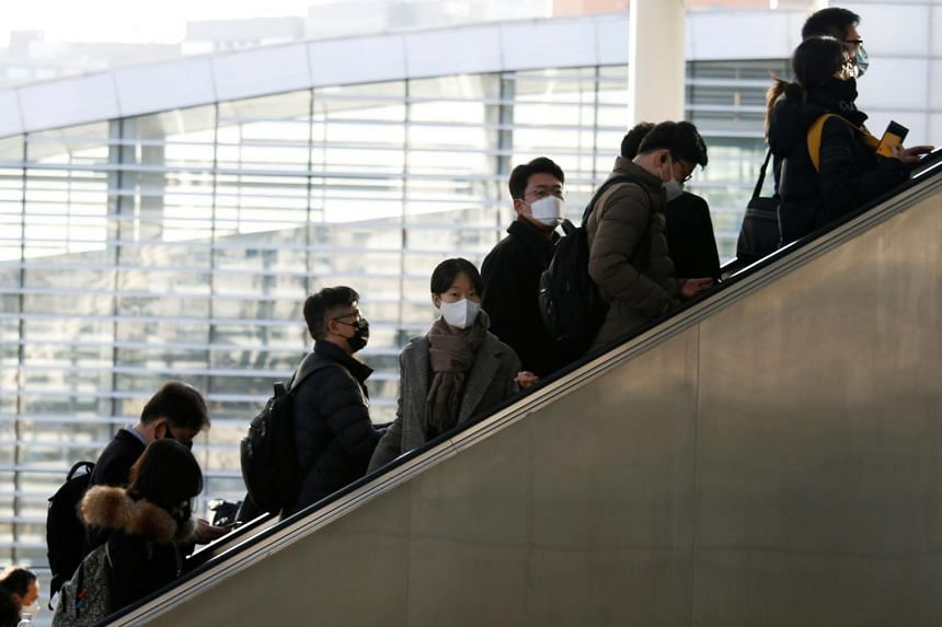 People wearing masks to protect themselves against the coronavirus are seen at the Seoul Railway Station in South Korea on Feb 10, 2020.