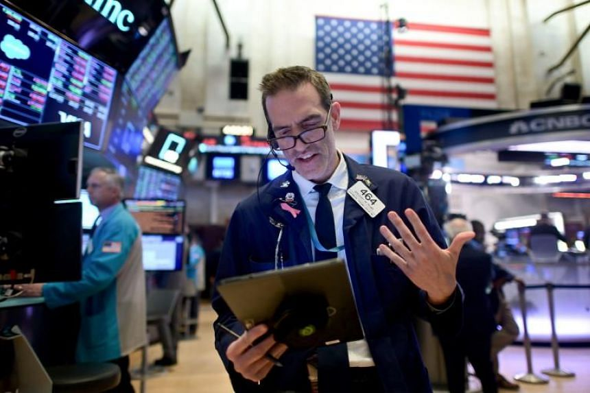 Traders work during the closing bell at the New York Stock Exchange on Wall Street.