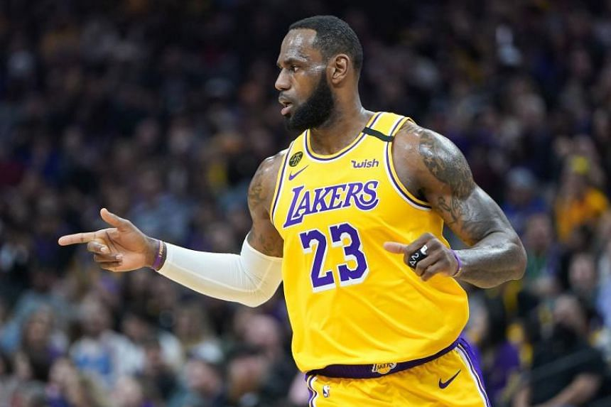 In a photo taken on Feb 1, 2020, LeBron James of the Los Angeles Lakers reacts after his team scored against the Sacramento Kings.