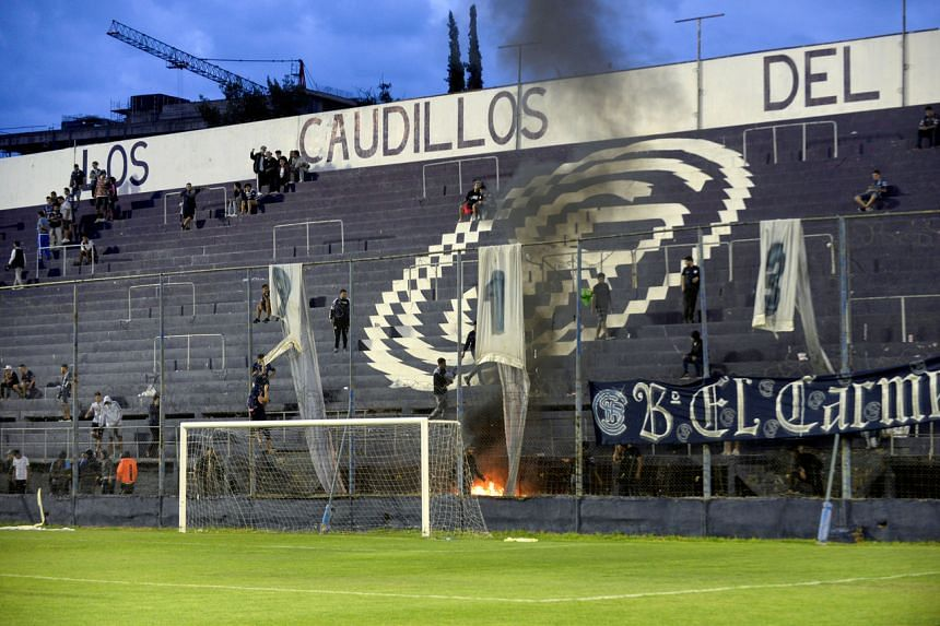 A fire started by Independiente Rivadavia fans during an Argentinian second-division match against Atlanta in Mendoza, Argentina, on Feb 9, 2020.