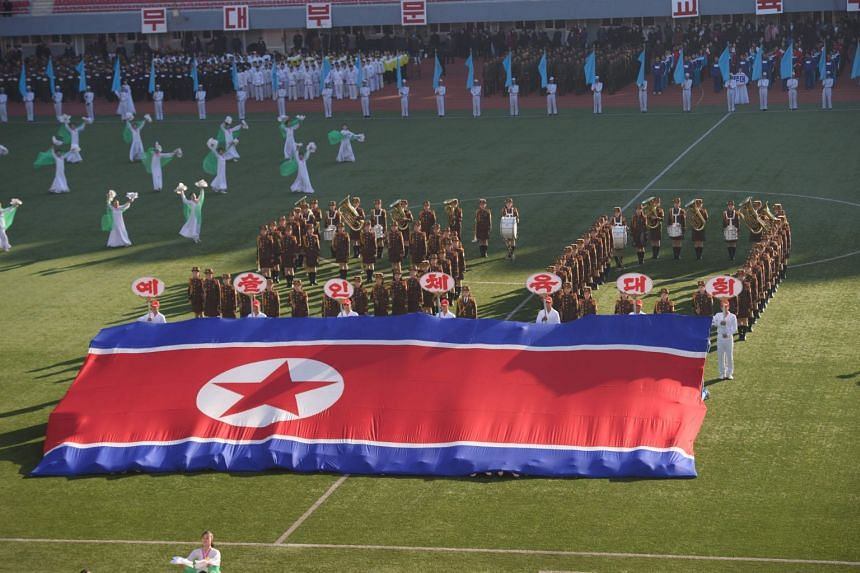 In a photo taken on Nov 8, 2019, a North Korean national flag is displayed on the field of the Kim Il Sung Stadium during a '50th Sports Contest of Artistes' in Pyongyang.