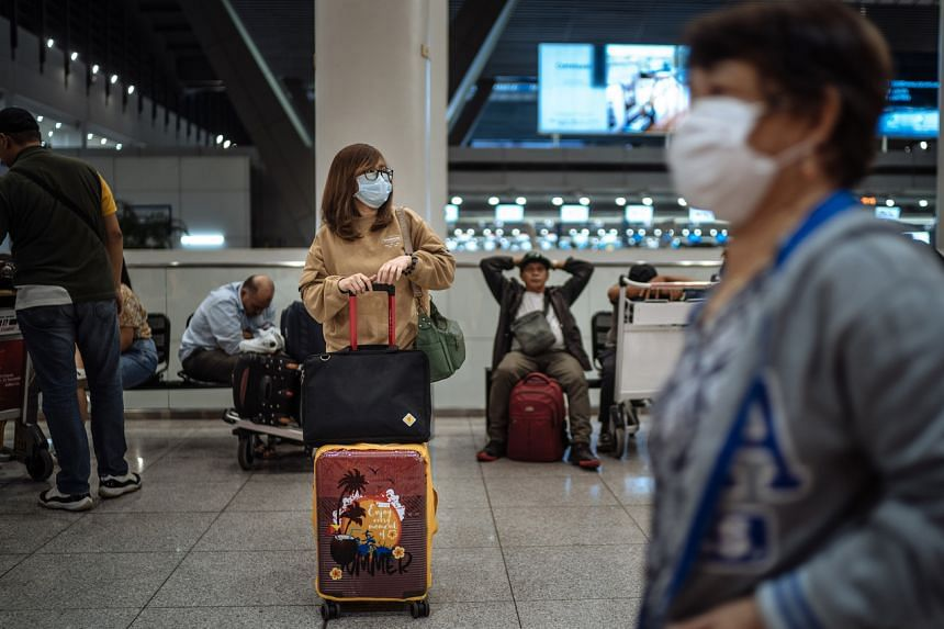 A woman waits after she was not allowed to board a flight to Hong Kong at the Ninoy Aquino International Airport in Manila on Feb 5. Philippine officials said the Taiwan travel ban would follow the same procedures as the previously announced restrict