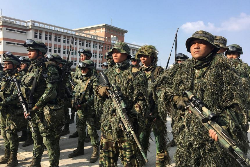 Taiwanese troops pose for pictures after conducting drills in front of the media, in Kaohsiung, on Jan 15, 2020.