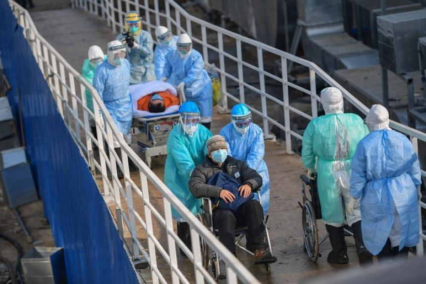 Medical staff transfer patients to the newly completed Huoshenshan temporary field Hospital in Wuhan, China, on Feb 4, 2020.