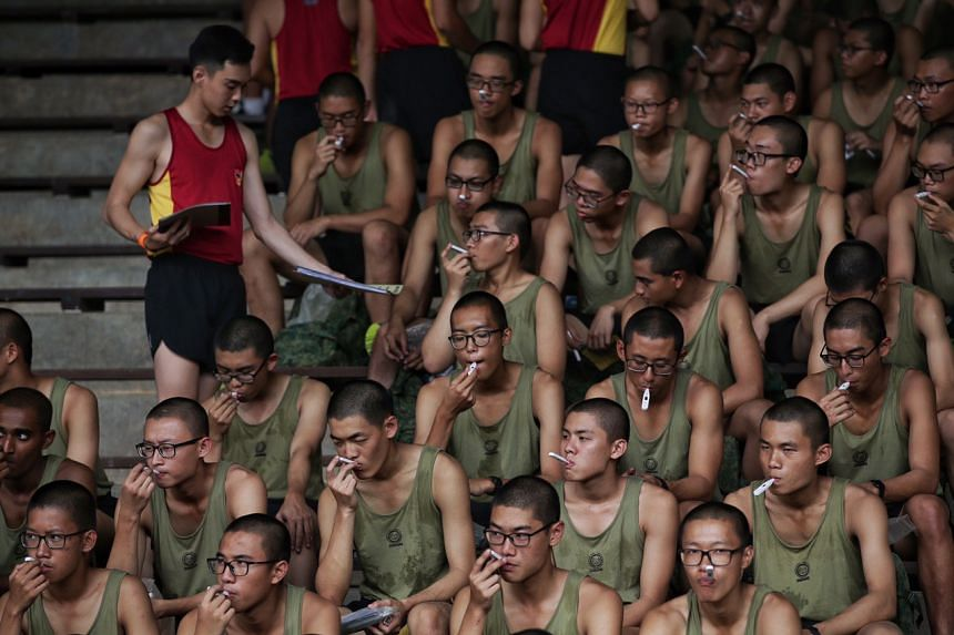 Recruits taking their temperature before strenuous physical activity at the Basic Military Training Centre in Pulau Tekong on Feb 11, 2020.