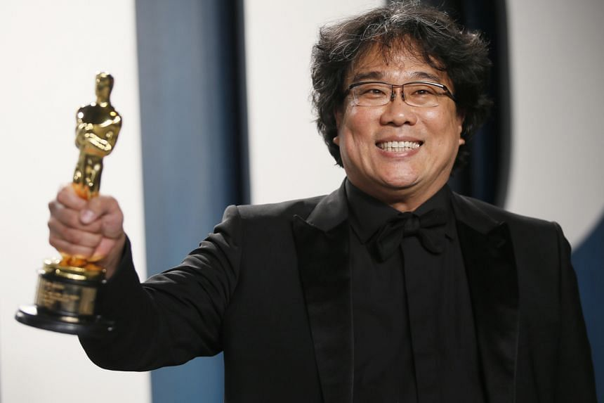 South Korean director Bong Joon-ho holds one of his Oscars for Parasite during the 92nd Academy Awards, in Los Angeles on Feb 9, 2020.