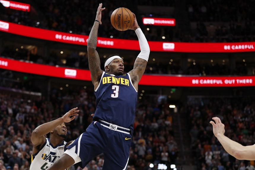 Denver Nuggets forward Torrey Craig (centre) grabs a rebound in the fourth quarter against Utah Jazz guard Donovan Mitchell at Vivint Smart Home Arena.