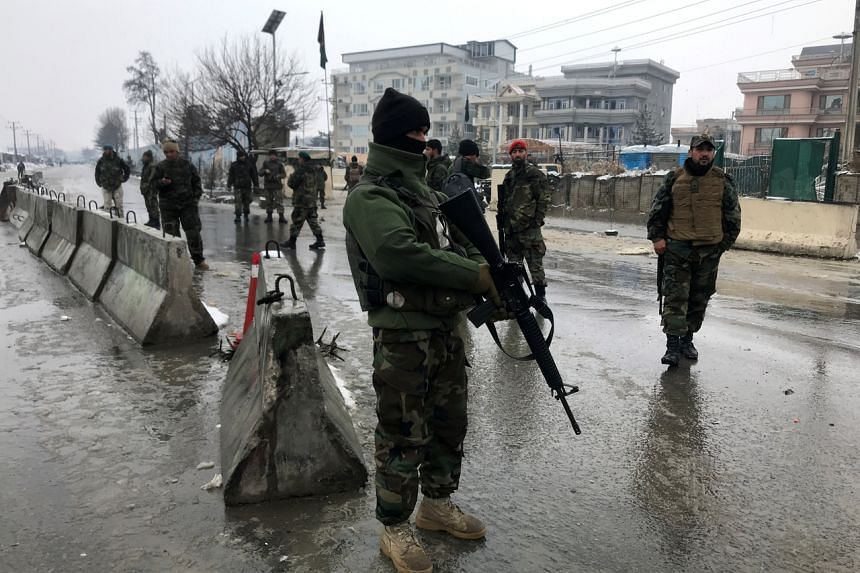 Afghan security forces keep watch at the site of a blast in Kabul, Afghanistan, on Feb 11, 2020.