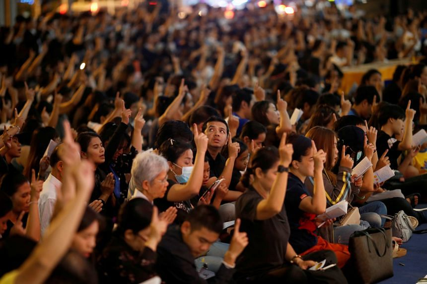 People pray for victims who died in a mass shooting at Terminal 21 shopping mall in Nakhon Ratchasima, Thailand, on Feb 10, 2020.