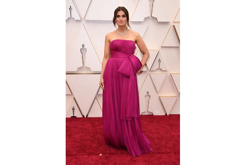 IDINA MENZEL: When will the stars finally learn that giant bows on the red carpet pretty much never pan out well? Why the Frozen singer went with this anyway is (Into The) Unknown.