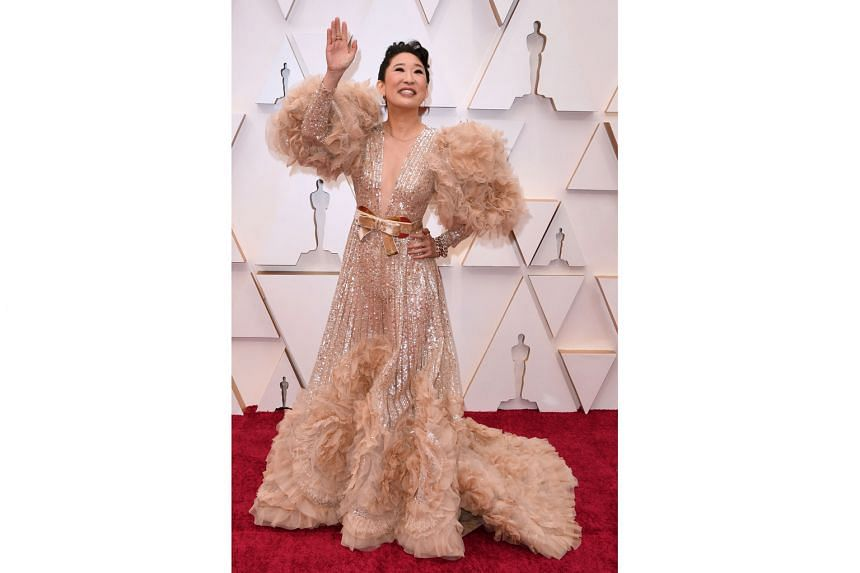SANDRA OH: Oh, Sandra. The usually elegant actress took a misstep with over-the-top tulle and feathery puffed sleeves, which bring to mind the feather dusters parents used to discipline children with back in the day - not an ideal association.