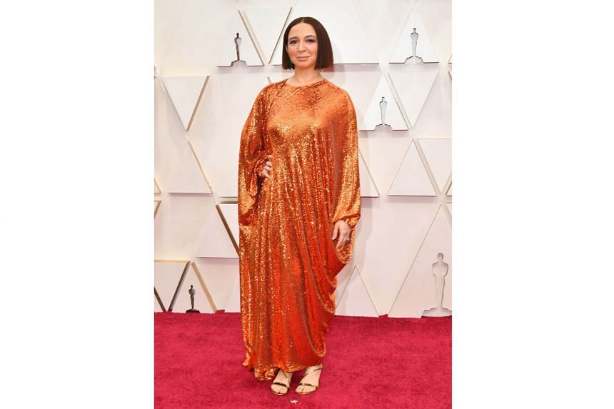 MAYA RUDOLPH: Another miss for the comedians, Rudolph's sequinned orange Valentino gown looks comfy but clumsy. Not even those green dangly earrings she says singer Beyonce once wore can save this look.