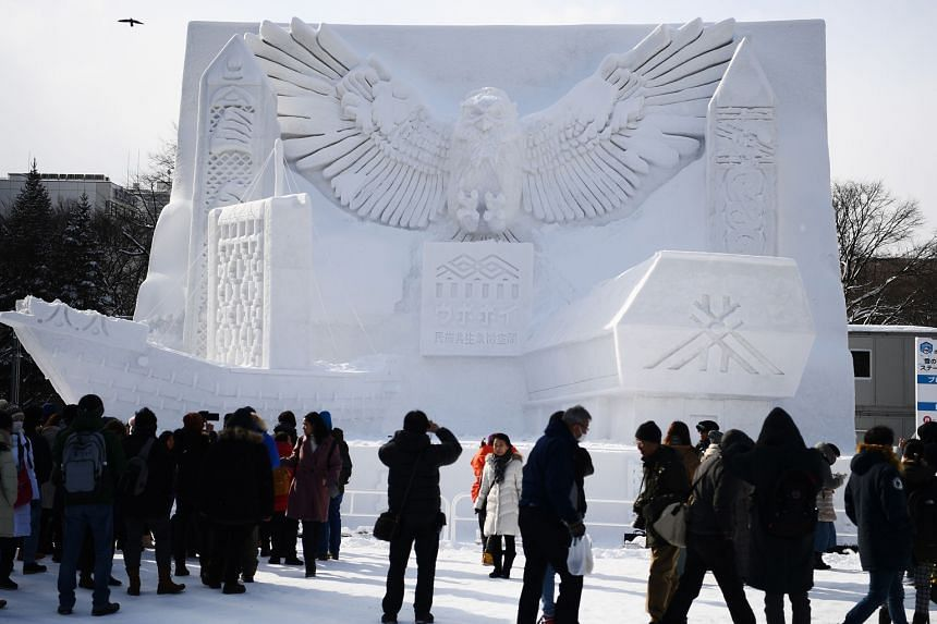 A statue of a giant Blakiston's fish owl at this year's Sapporo Snow Festival, the main theme of which is Hokkaido's ethnic Ainu minority. The owl is considered a god in Ainu culture.