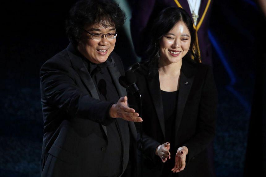 Director Bong Joon-ho and interpreter Sharon Choi at the Oscars. Choi, also a film-maker, has followed the Parasite team throughout the awards season.