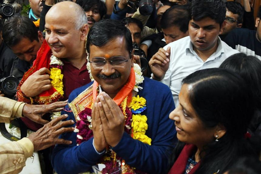 Aam Aadmi Party (AAP) chief and Chief Minister of Delhi Arvind Kejriwal (centre) visits the Hanuman temple after AAP won the Delhi Assembly elections, on Feb 11, 2020.