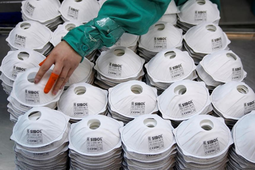 Masks are seen on a production line at a factory in Shanghai on Jan 31, 2020.