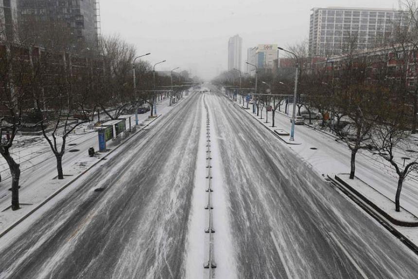 An empty street is seen in Beijing on Feb 5, 2020.
