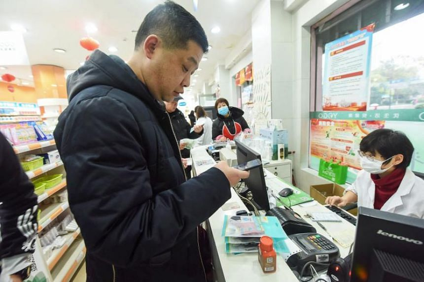 People buying medical supplies at a pharmacy in Hangzhou, in China's eastern Zhejiang province, on Jan 23, 2020.