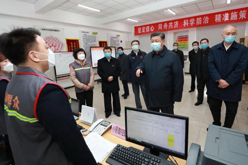 Chinese President Xi Jinping inspecting the novel coronavirus pneumonia prevention and control work at Anhuali Community in Beijing on Feb 10, 2020.