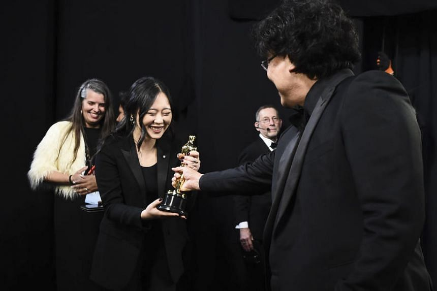 Best Director award winner Bong Joon-ho with interpreter Sharon Choi backstage during the 92nd Annual Academy Awards on Feb 9, 2020.