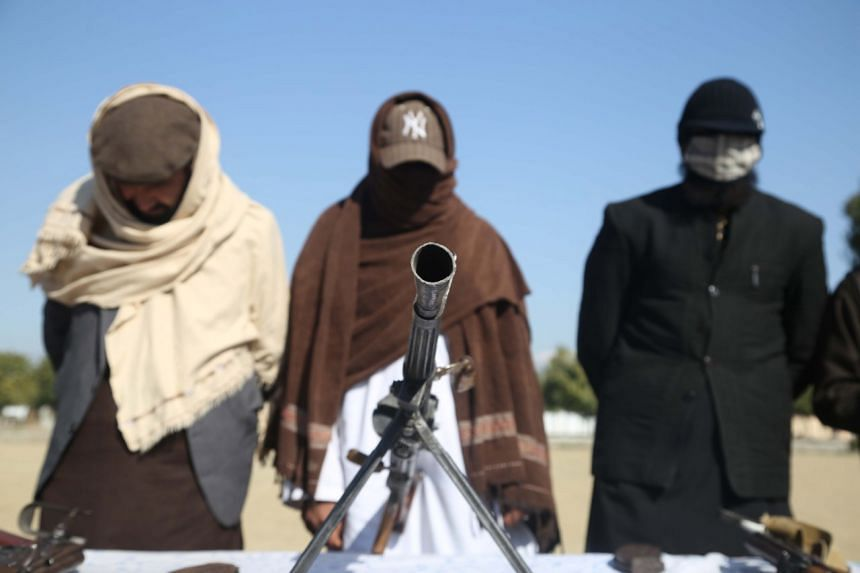 Former militants surrender their weapons during a reconciliation ceremony in Jalalabad, Afghanistan, Feb 8, 2020.