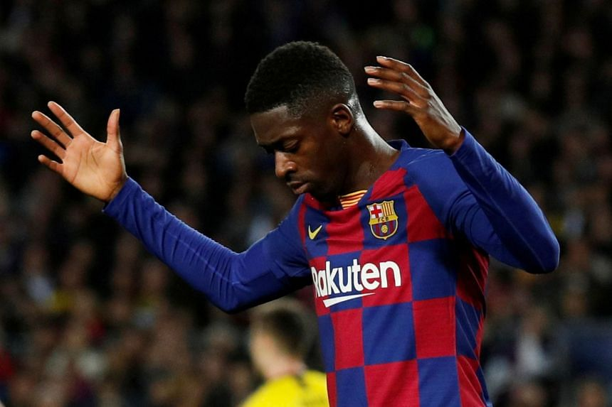 Barcelona's Ousmane Dembele reacts during a match.