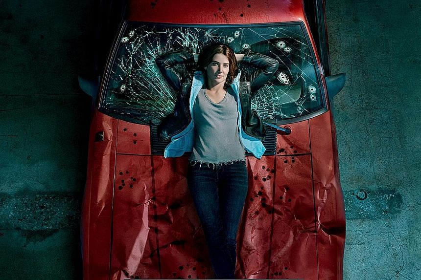 Actress Cobie Smulders, 37, drew on her experience of being diagnosed with ovarian cancer at age 25 for her role as a private investigator suffering from post-traumatic stress disorder in Stumptown.
