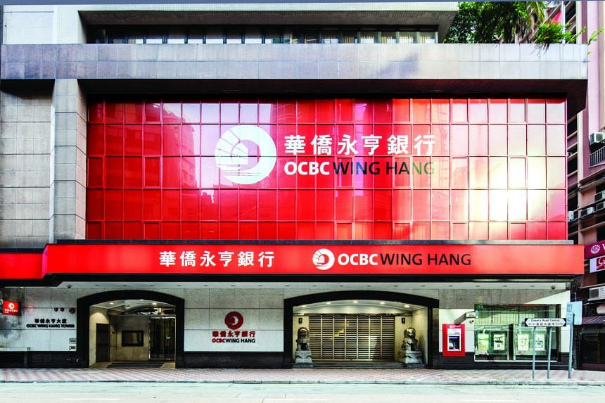 OCBC Wing Hang China (right) has directed staff to hold meetings via telephone or video conference calls, and those who must meet face to fast will wear face masks, said CEO Wang Ke (below).