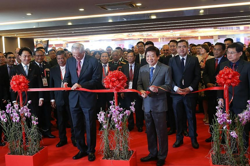 Defence Minister Ng Eng Hen (left) and Transport Minister Khaw Boon Wan jointly opened the Singapore Airshow 2020 at a ribbon-cutting ceremony yesterday. The ministers were then taken on a guided tour of the exhibits, stopping at local exhibitors suc