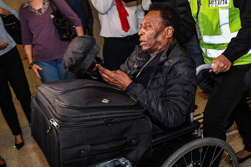 Pele, seen at the Guarulhos International Airport near Sao Paulo last year, is reliant on a walker these days, with the 79-year-old Brazilian's health beginning to take a toll on him. PHOTO: AGENCE FRANCE-PRESSE
