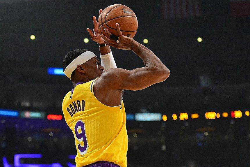 Los Angeles point guard Rajon Rondo taking one of 13 shots against the Phoenix Suns. He made nine field goals for a season-high 23 points off the bench to help the Lakers ease to their 40th win this season. PHOTO: REUTERS