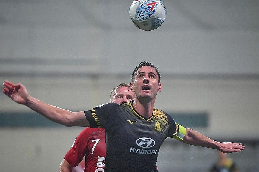 Tampines Rovers' Daniel Bennett keeping a watchful eye on the ball during their AFC Champions League play-off against Bali United. The Stags' defensive stalwart will be counted upon by coach Gavin Lee to shore up his side's rearguard. ST PHOTO: ARIFF