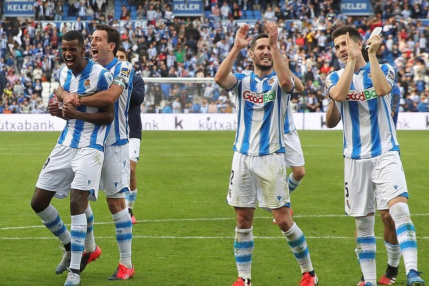 Real Sociedad players celebrating their 2-1 victory over Basque rivals Athletic Bilbao at Anoeta Stadium in San Sebastian on Sunday. Six Sociedad starters were nurtured at their Zubieta academy. PHOTO: EPA-EFE