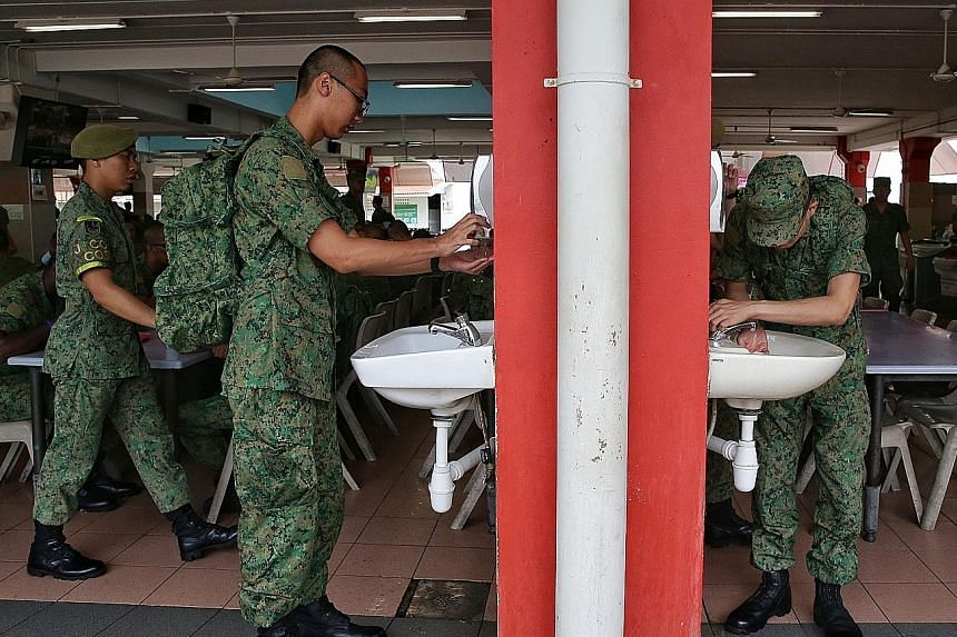 At the Basic Military Training Centre, hand-washing before meals has been made mandatory. Meal times have also been staggered such that only two companies will eat at the cookhouse at one time. The cookhouse can accommodate four to five companies. ST