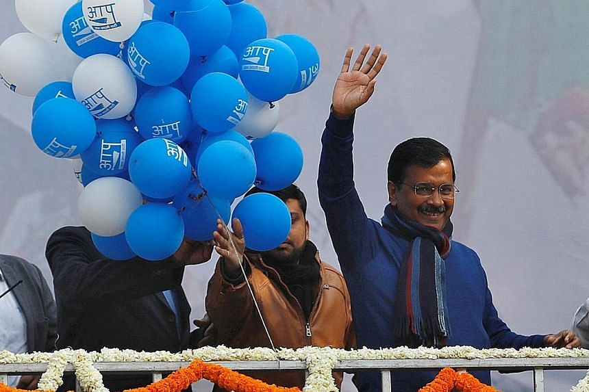 Delhi Chief Minister and leader of seven-year-old Aam Aadmi Party Arvind Kejriwal waving to his supporters during celebrations at the party headquarters in New Delhi, India, yesterday. PHOTO: REUTERS