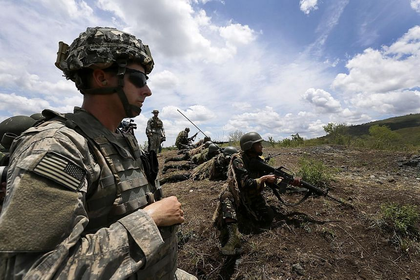 A 2014 photo showing the US and the Philippines conducting joint military live fire exercises at Fort Magsaysay army training camp in the Philippine province of Nueva Ecija.