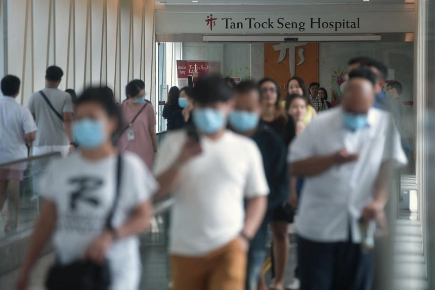 A photo from Feb 4, 2020, shows people with masks at the link bridge to Tan Tock Seng Hospital.