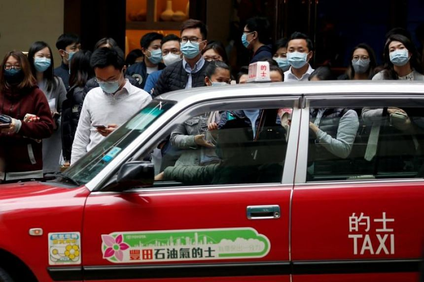 People in Hong Kong wearing protective masks on Feb 10, 2020, following the outbreak of the coronavirus.