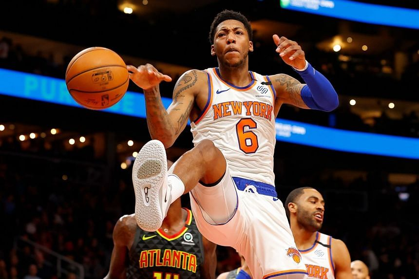 Elfrid Payton of the New York Knicks slaps the ball after dunking against the Atlanta Hawks in the first half at State Farm Arena on Feb 9, 2020, in Atlanta, Georgia.
