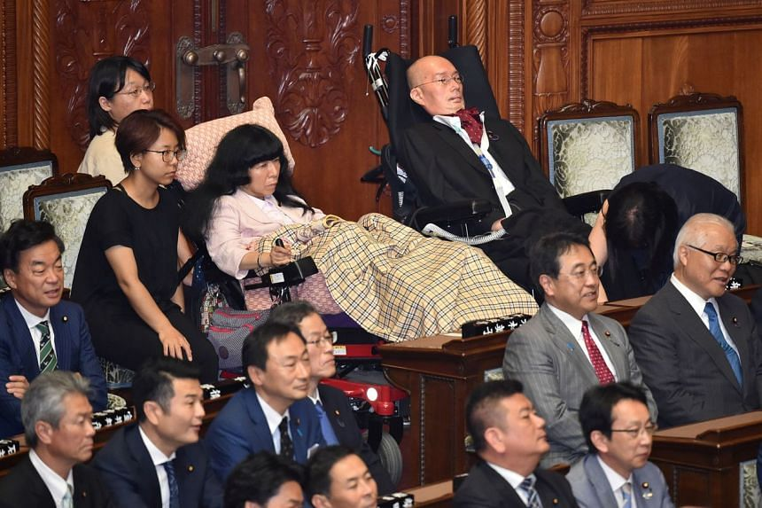 In a photo taken on Aug 1, 2019, wheelchair-bound Japanese lawmakers Eiko Kimura (top, second from right) and Yasuhiko Funago (top, right) attending the opening ceremony of an 'Extraordinary Diet' session at the Upper House plenary hall in Tokyo.