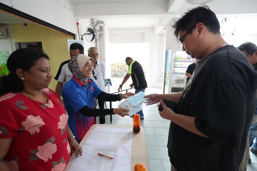 Residents collecting their masks from the mask collection counters at the Residents' Committee centre at Block 47 Telok Blangah Drive, on Feb 2, 2020.