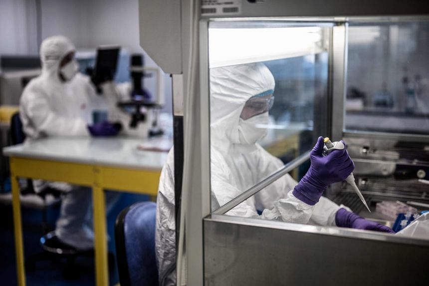 """Scientists at work in the VirPath university laboratory, classified as """"P3"""" level of safety, in Lyon, France, on Feb 5, 2020, as they try to find an effective treatment against the coronavirus."""