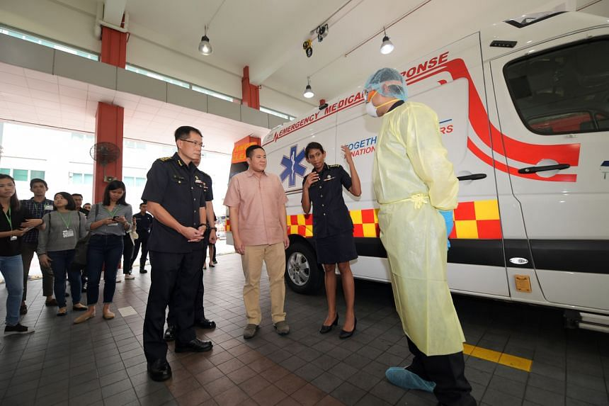 Senior Parliamentary Secretary for Health and Home Affairs Amrin Amin (centre) during a visit to the Singapore Civil Defence Force headquarters in Ubi on Feb 12, 2020.