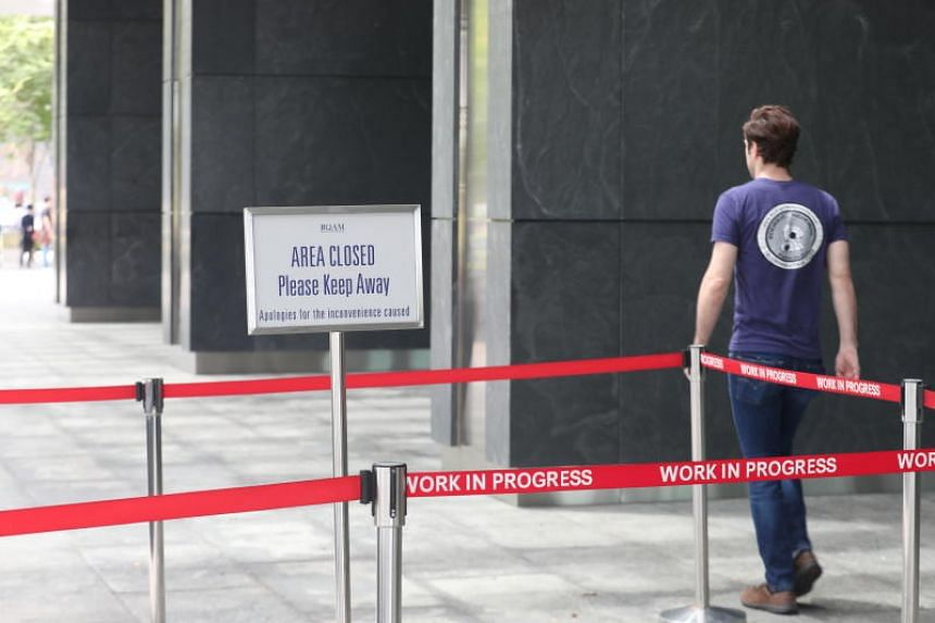 Thermal scanners at the entrance of Marina Bay Financial Centre and signs put up outside the building on Feb 12, 2020.