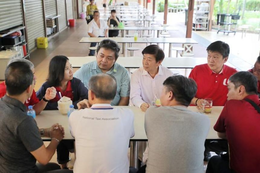 Transport Minister Khaw Boon Wan (back row, centre) and NTUC secretary-general Ng Chee Meng (to his right) meeting meeting taxi and private-hire drivers at Newton Food Centre on Feb 12, 2020.