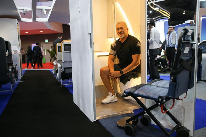 National para-powerlifter Kalai Vanen in the expandable aircraft lavatory developed by ST Engineering at the Signapore Airshow 2020 on Feb 12, 2020.