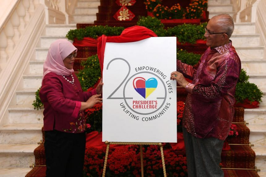 In a photo taken on Jan 26, President Halimah Yacob and Mr Mohamed Abdullah Alhabshee unveil the new President's Challenge 2020 logo and tagline.