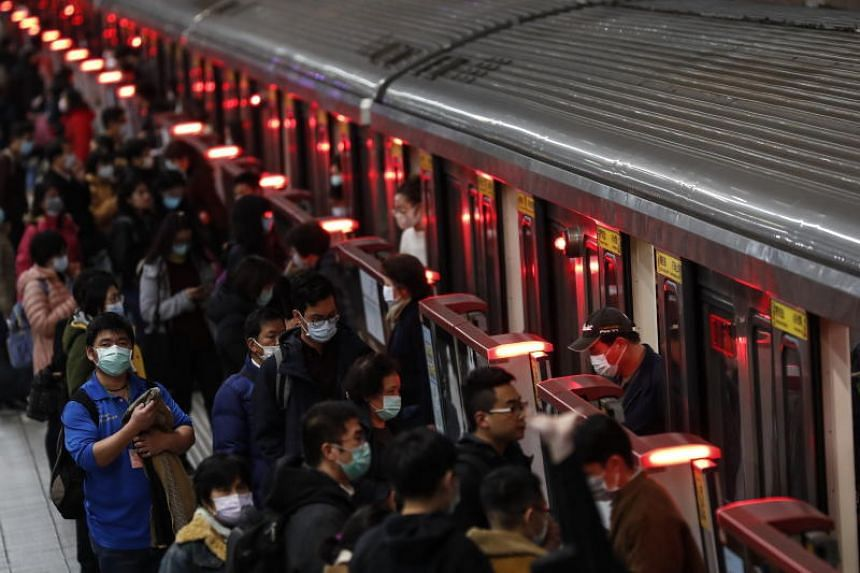 People wearing masks board a train in Taipei on Feb 10, 2020. Taiwan's lack of World Health Organisation membership has been an increasingly sore point for the island amid the virus outbreak.